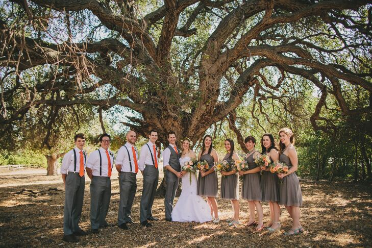 The bridesmaids all wore neutral knee-length dresses in a shade of gray from J.Crew. They selected their own choice of shoes and jewelry based on the orange and mint palette.
