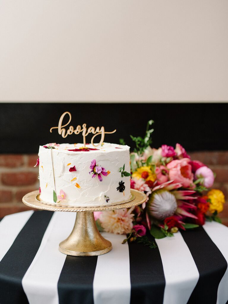 Small simple wedding cake with pressed flowers
