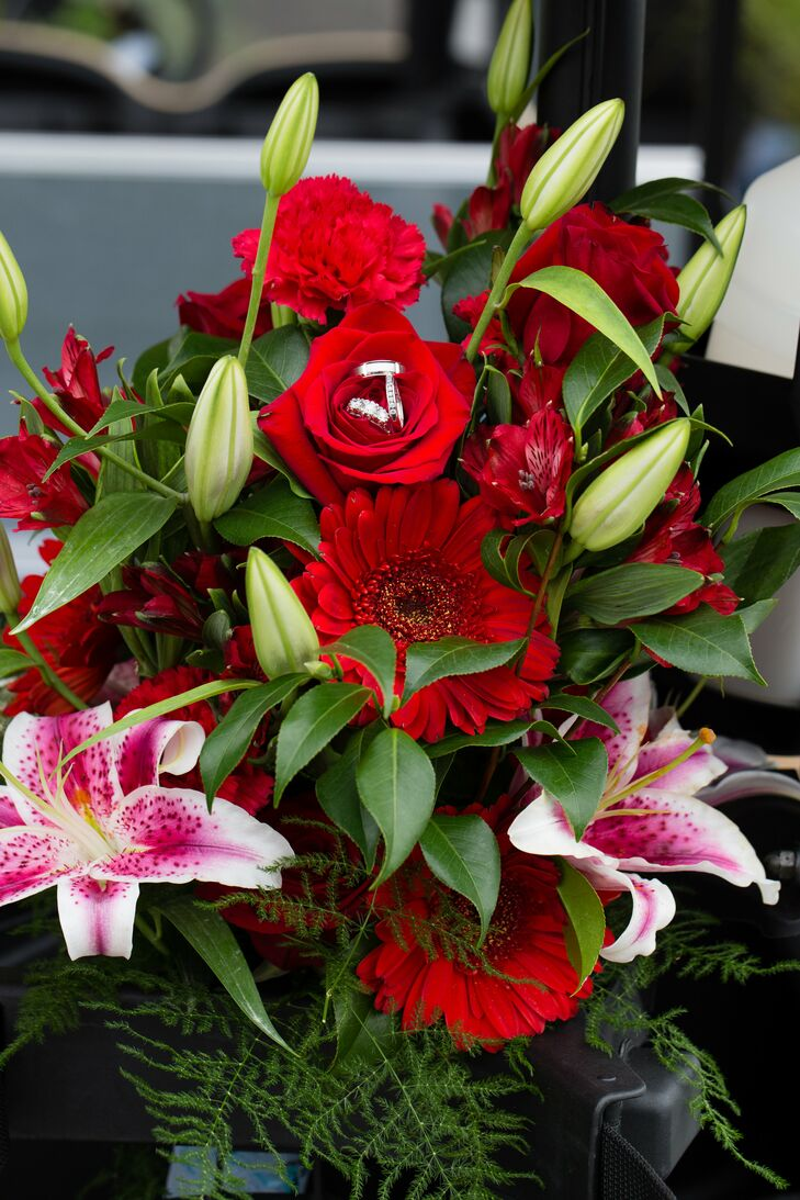 The bride's bouquet had red gerbera daisies, roses, carnations and alstroemeria with pink stargazer lilies arranged by Schmidt's Flowers.