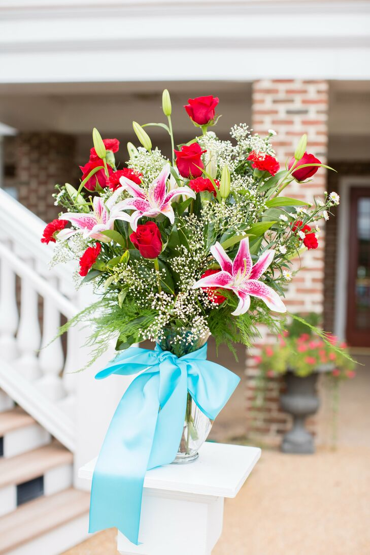 Red and Pink Bouquet With Blue Ribbon