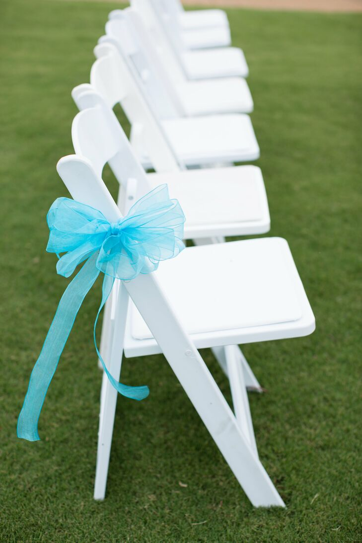 White Reception Chairs With Blue Ribbon