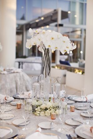 White Orchid Centerpieces in Tall Hurricane Vases