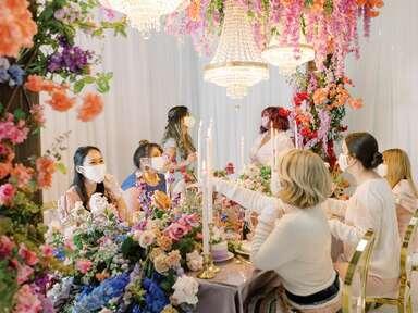 Guests toasting at Bridgerton-themed tea party bridal shower