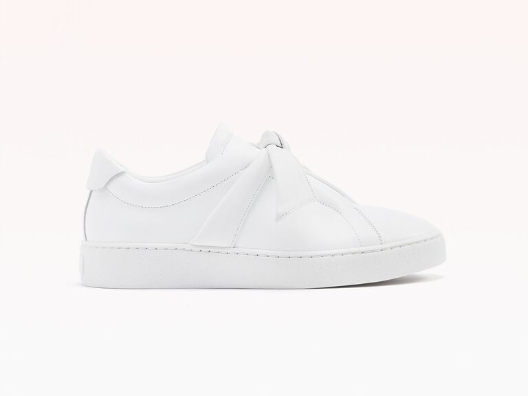 Allover white sneaker with statement bow detail