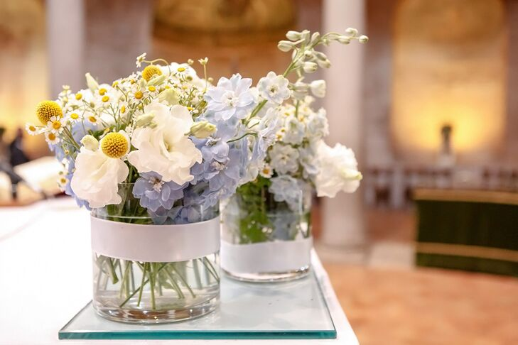 The centerpieces contained wildflowers, hydrangeas and craspedia in vintage glass jars.