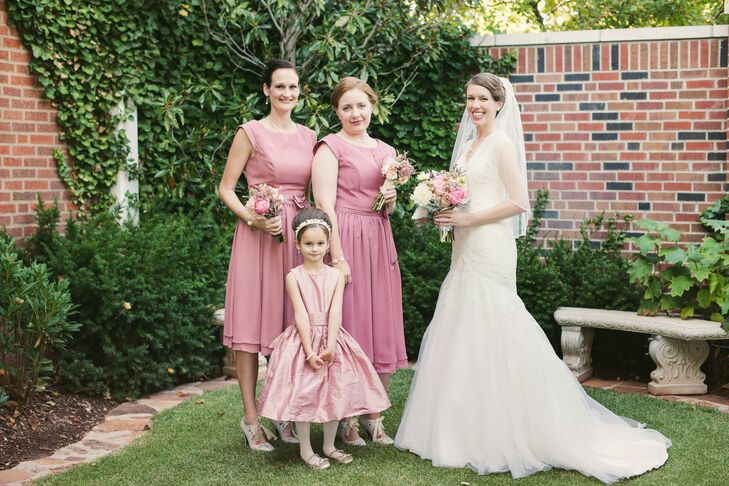 "Chelsea's maid of honor and bridesmaid wore dusty rose short-sleeve dresses and carried matching whimsical bouquets. Her ""bride announcer"" wore a dusty rose dress with a sophisticated updo and headband to match the elegant, vintage style."