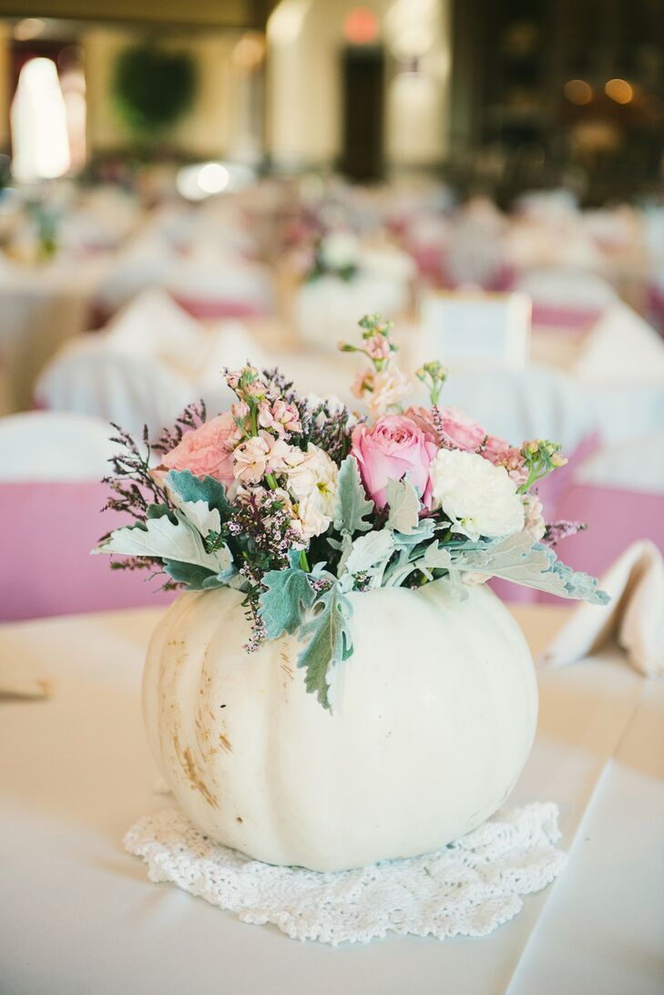 Chelsea and Jeffrey got engaged while carving pumpkins, so naturally they included pumpkin decor in their fall wedding. They carved pumpkin centerpieces that doubled as vases for blush and ivory flower arrangements.
