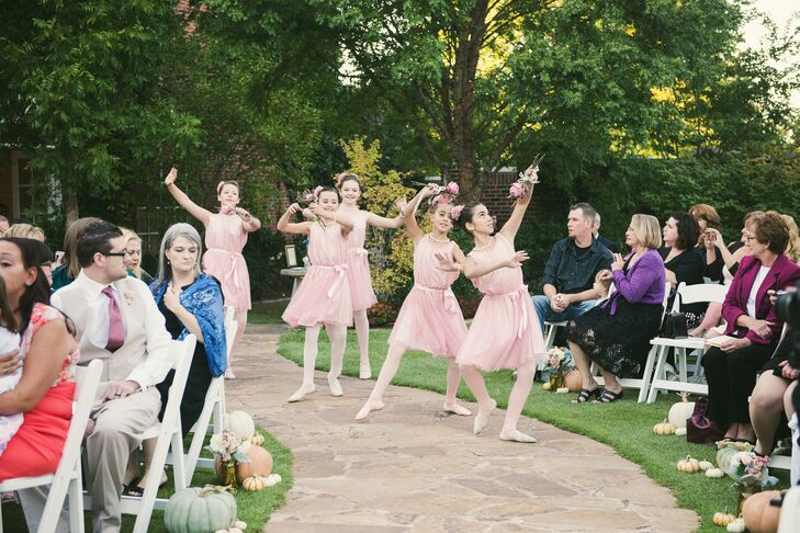 Chelsea's flower girls, who were also her dance students, performed during her wedding. They were dressed like ballerinas, with blush dresses and flower crowns.