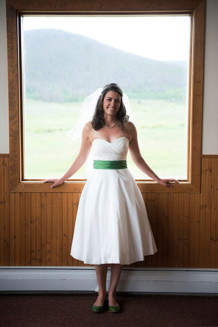 d5cbe331840 Elizabeth wore a more traditional strapless wedding dress that she altered  to be tea length.