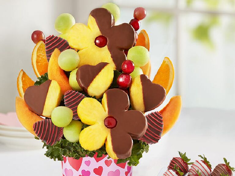 Floral arrangement made out of chocolate-dipped fruit