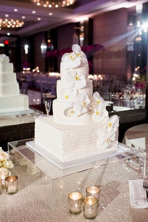 Modern, All-White Cake with Cascading Orchids
