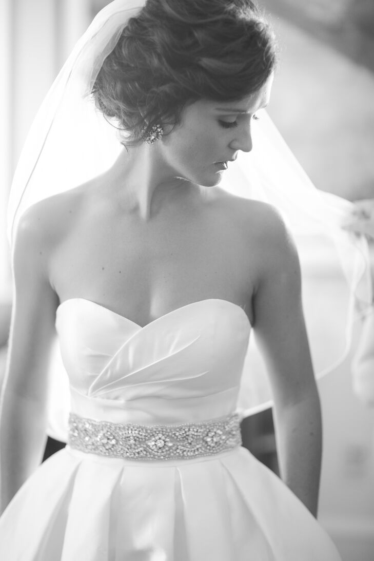 The bride wore a Steven Birbaum gown from Posh in Wayzata, Minnesota. She wanted a fun flirty dress that she would be able to dance in. She added fun earrings from J.Crew and a homemade belt created by local business owner A.B Ellie.
