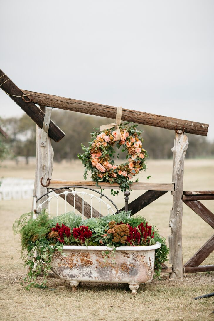 Lush florals in a claw-foot bathtub made for an unexpected ceremony arrangement.