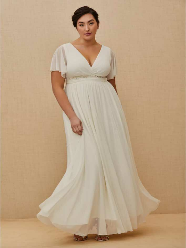 Simple white wedding dress with flutter sleeves, V-neckline and empire skirt