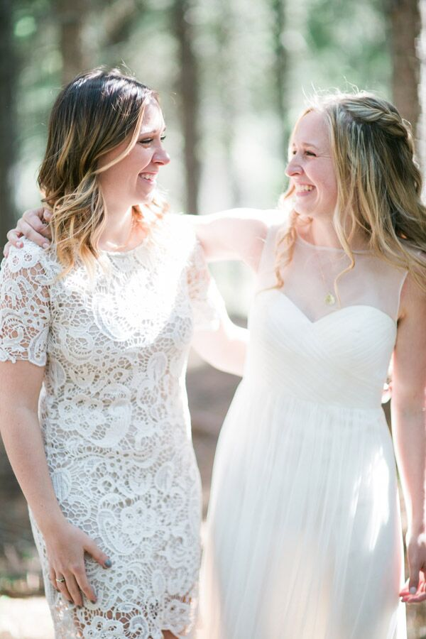 Christine's sister, who was her maid of honor, wore a pretty ivory lace wedding dress. She and Christine styled their hair naturally, and Christine wore her hair half-up in a loose braid crown.