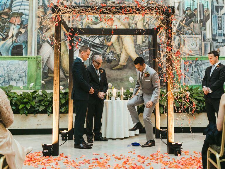 Jewish wedding ceremony grooms smashing glass under chuppah