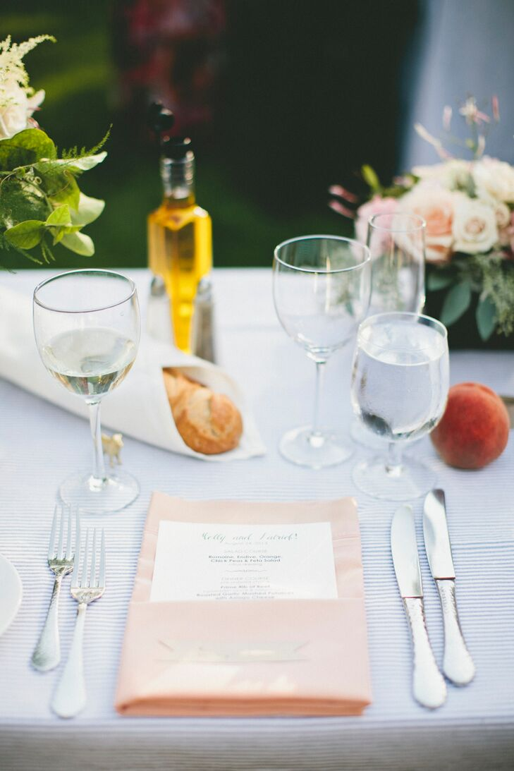 Blue striped linens punctuated with blush and peach florals and pale peach colored napkins set a laid-back tone for the evening's festivities and make guests feel as though they were sharing a family dinner at home. After dinner and dancing, Molly and Patrick treated guests to late night snacks like grilled cheese sandwiches and French fries to keep the party going late into the night.