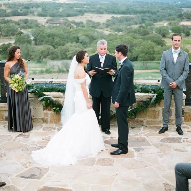 The ceremony was held in front of a picturesque overlook with views of the rolling hills. We wanted the location to speak for itself, so flowers were kept to a minimum and the aisle was lined with green garland, says Erin.