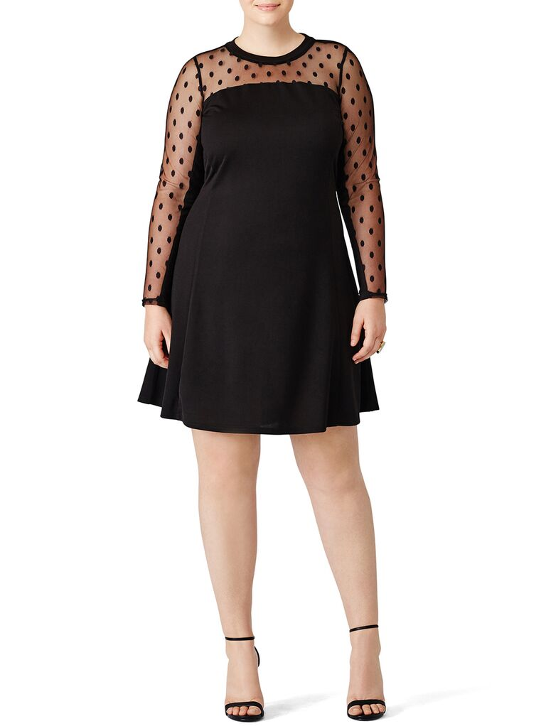 Black mini dress with sheer neckline and long sleeves with embroidered black polka dots