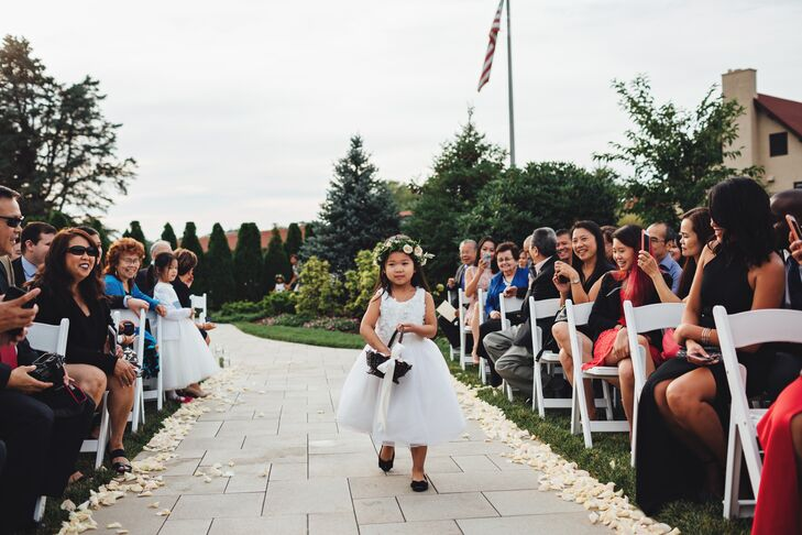 The couple's flower girl looked as if she had stepped out of the pages of a storybook with her whimsical full-skirt tulle gown and garden-inspired flower crown filled with pale pink florals.