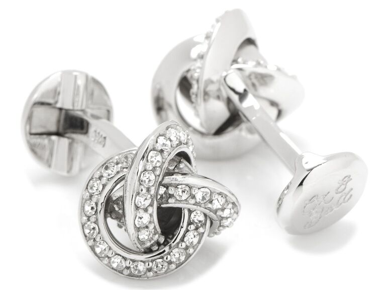 Pair of white Swarovski crystal-studded cuff links in love knot design