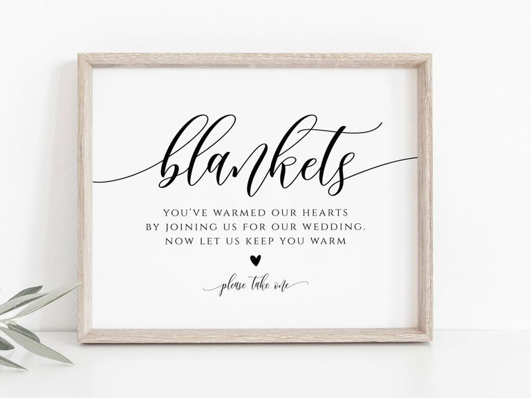 Blanket station signage for cold and rainy wedding day
