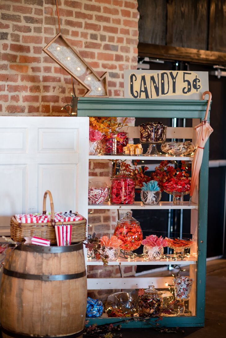 """A candy bar was created out of an old cabinet. """"Beautiful favor bags could be filled with every candy imaginable,"""" Maggie says. """"A huge hit for all, especially the 10-and-under crowd."""""""