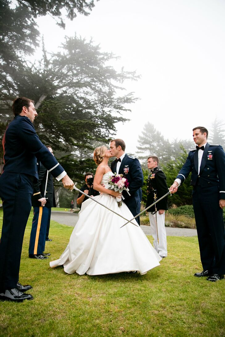 Jeff and Kim kissed between two swords drawn by Jeff's military friends in uniform.