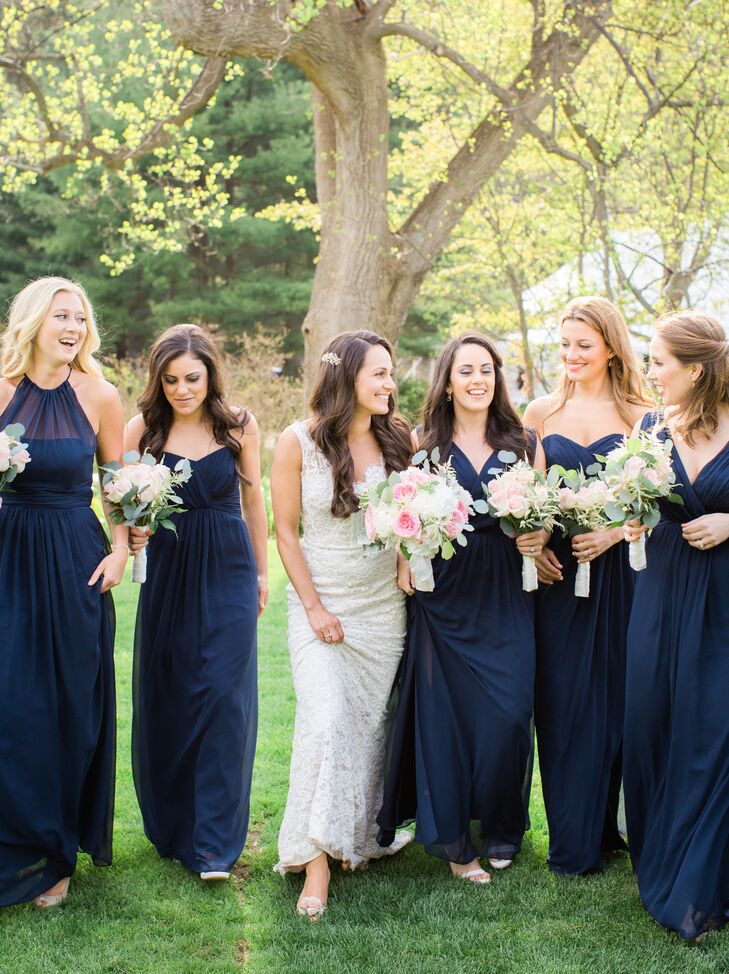 The bride had her bridemaids select their own dress styles, all in navy blue chiffon from the Dessy Group.