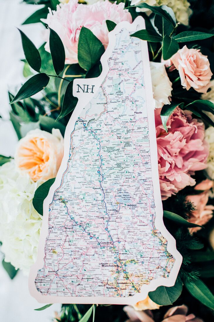 "Infusing the day with personality was important to Shaylyn and Ryan, so the couple looked to their love of travel to add to the decor. ""We've taken many road trips through the US together, and Ryan can spend hours looking at atlases and travel books dreaming up adventures for us to take,"" Shaylyn says. ""So instead of doing the traditional table numbers, we labeled each of our 15 tables with a state we have traveled to together within the US."" The couple used Ryan's atlases to cut out the silhouette of each state and mounted them on pale pink or gray card stock. They then hand-stamped each state with their corresponding abbreviation."