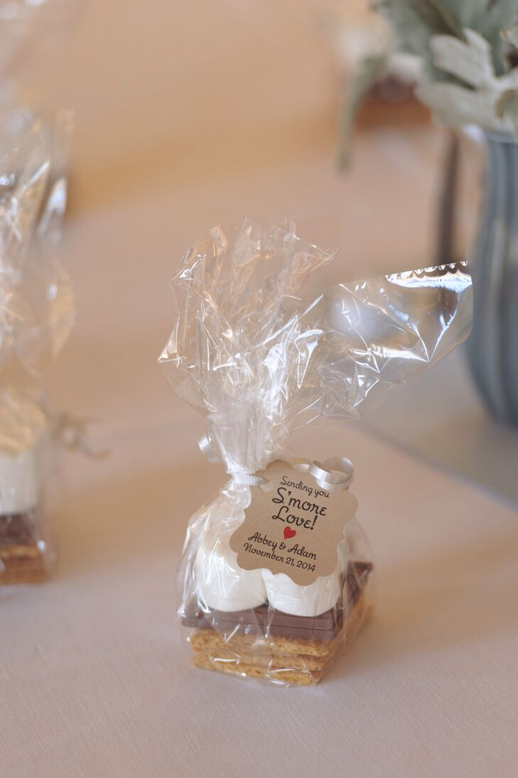 """Abbey and Alex ensured that each of their guests left with a bag of their favorite treat, s'mores. """"Our family slaved over creating the cute gifts,"""" says Abbey."""