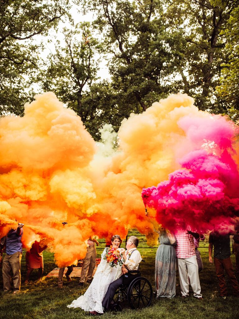 Vow renewal picture with colorful smoke