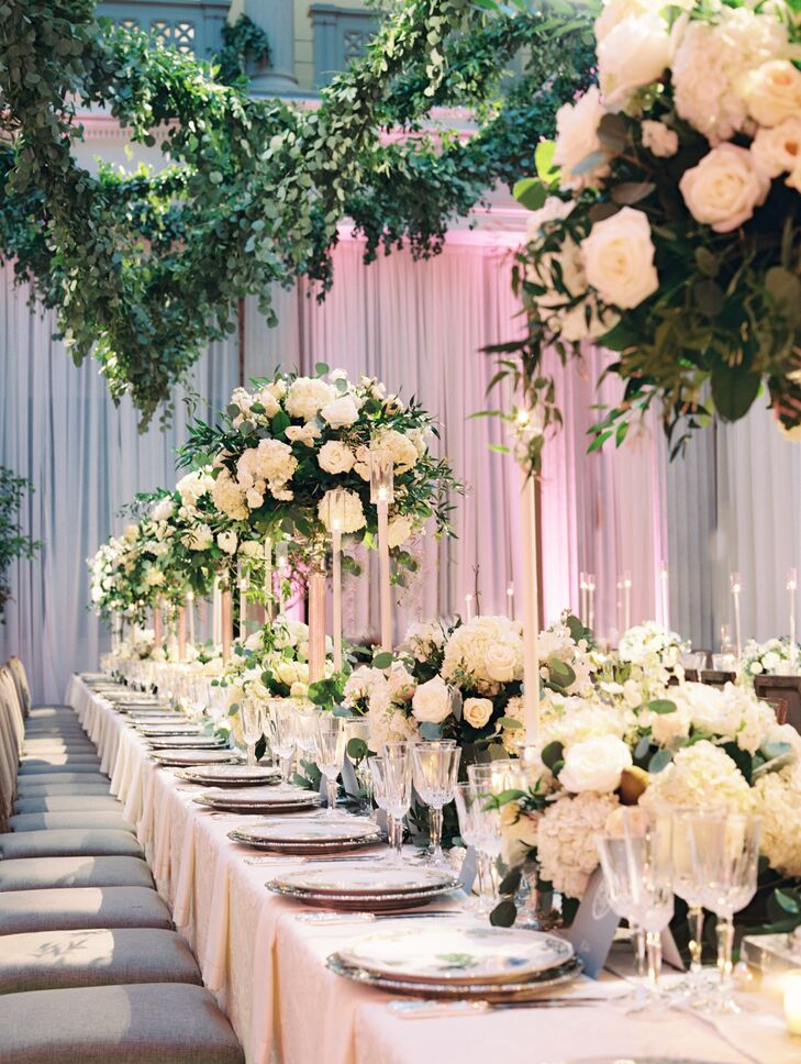 Dripping garland, long tables and tall centerpieces filled the soaring two-story space.