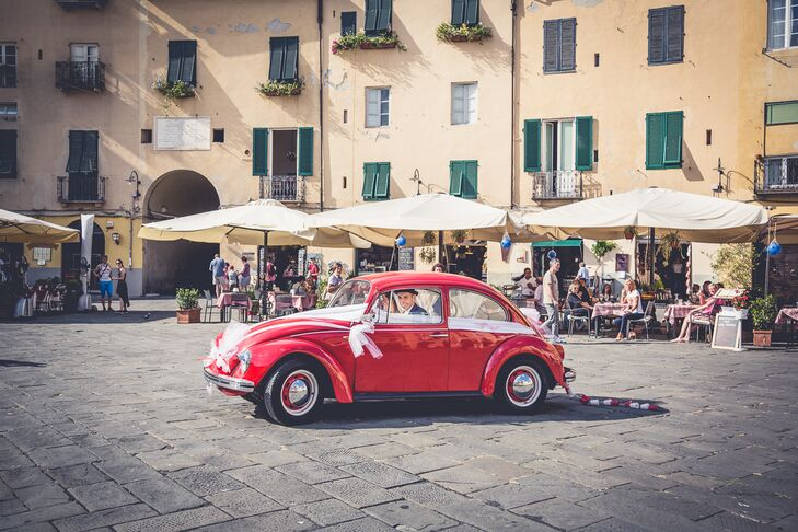 Vintage Car Exit in Lucca, Tuscany, Italy