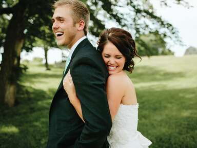 Laughing bride and groom portrait