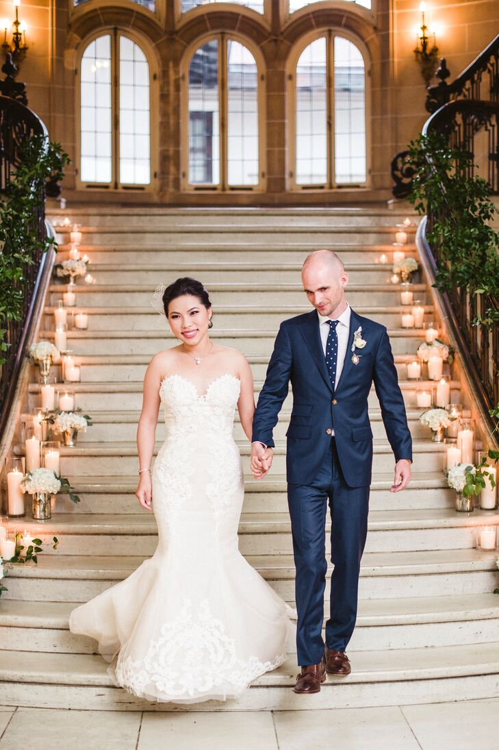 Candles lined the magnificent stairway, starting with small candles at the top then gradually growing larger in size. Greenery decorated the railings, and small arrangements of white hydrangeas and seeded eucalyptus added to the ambiance.