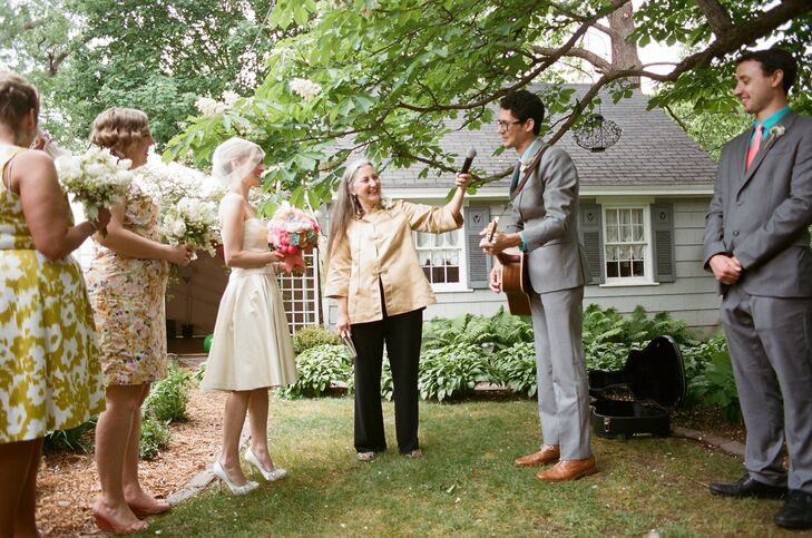 The groom's mother served as the officiant at the backyard ceremony. Our ceremony sermon was so personal, endearing and real. It was truly about us as individuals and as a couple, says Krissy.