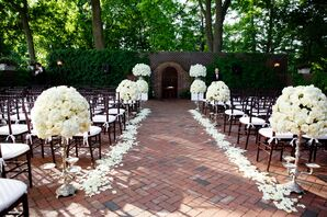 Courtyard Ceremony With White Floral Aisle Decor