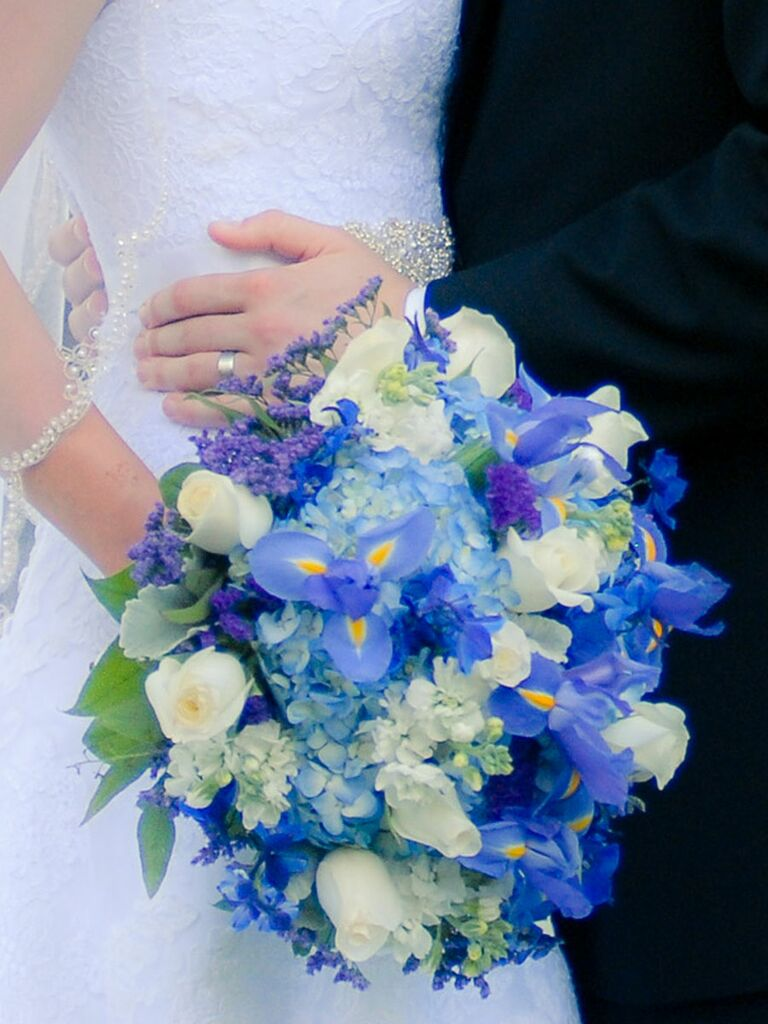 Blue wedding bouquet with irises​, hydrangea, roses, stock flower