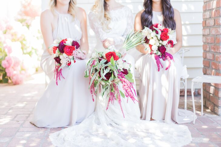"Each bridesmaid chose a different style of dress in blush tone from ShowMeYourMumu.com. Their vibrant bouquets matched Jenna Mae's and consisted of crimson and white roses and trailing hyacinths. ""The garden we were married in had a lot of light-colored flowers, so I tried to make my bouquet really pop by adding deep reds and purples,"" Jenna Mae says."