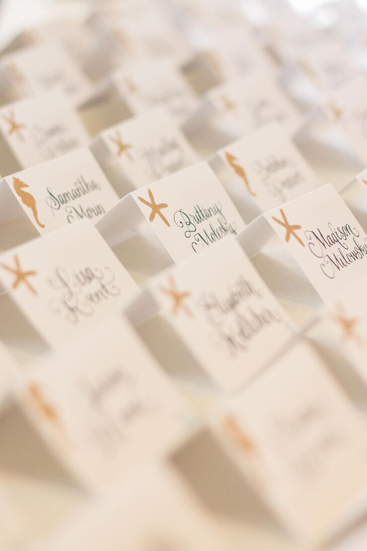 Tying into the wedding's nautical, beach theme, Alexandria and Brennan added a starfish and seahorse motif to the escort cards.
