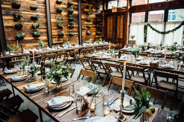 The rustic, intimate vibe of the Brooklyn Winery with its wood-paneled walls and high ceilings set the tone for the couple's decor. Jennifer's friend arranged lush eucalyptus and rose centerpieces to infuse the tables with a fresh, organic feel, while the inclusion of brass candlesticks cast a warm ambient glow over the room.