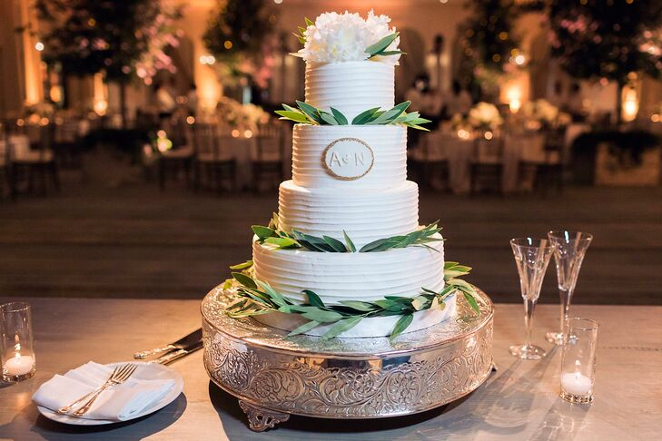 Guests enjoyed champagne cake with English toffee filling, and caramel cake with sea-salt caramel filling. Rather than using a cake topper, the couple chose to adorn their cake with lush flowers and greenery, with a small decal of their initials.