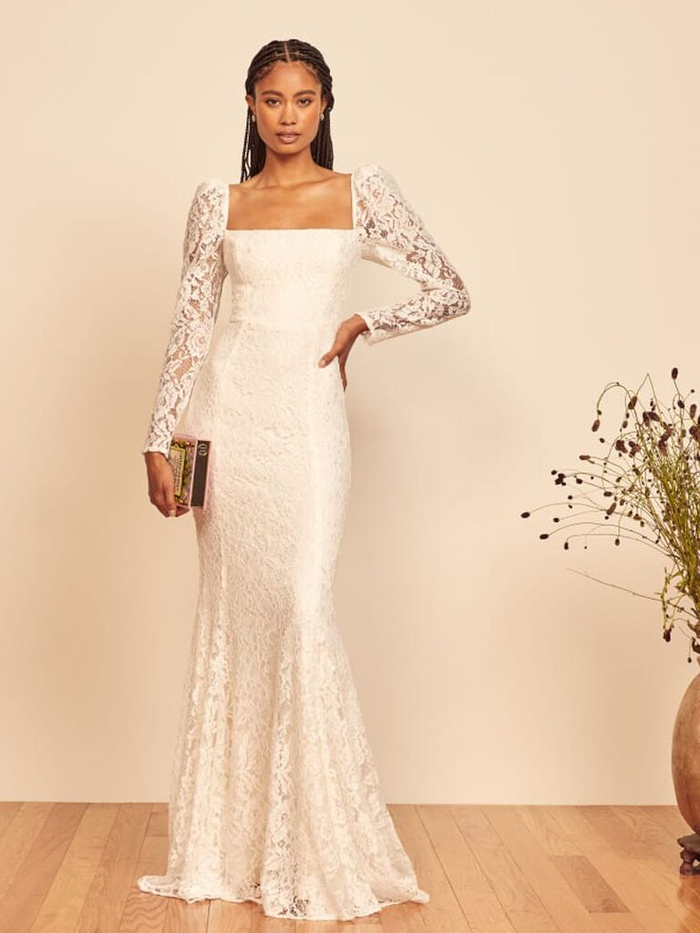 Fitted lace dress with long sheer lace sleeves and puff shoulders