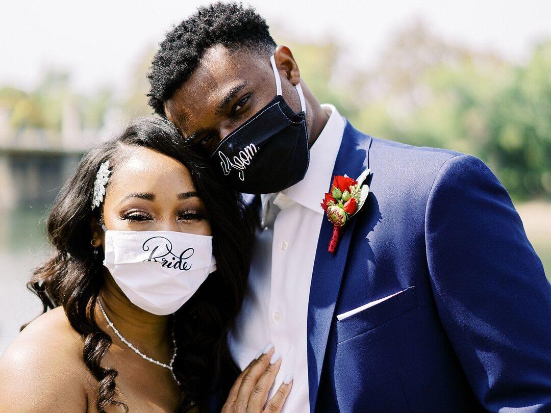 Bride and groom wearing face masks at wedding