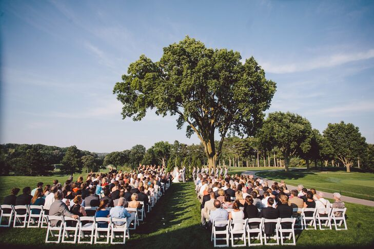 Guests gathered on the expansive landscaped lawns of the Omaha Country Club for the ceremony. A large shade tree made for a stunning natural backdrop.