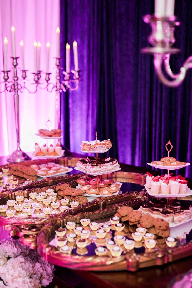 After a traditional sit-down dinner by the pool, Ken and Pat invited guests to visit their Venetian room and indulge in a showstopping spread of bite-size sweets. Parfaits, petit tarts, cookies and were offered instead of a standard wedding cake.