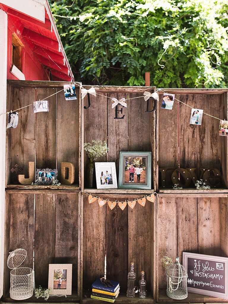 Welcome table idea with wooden crates and family photos