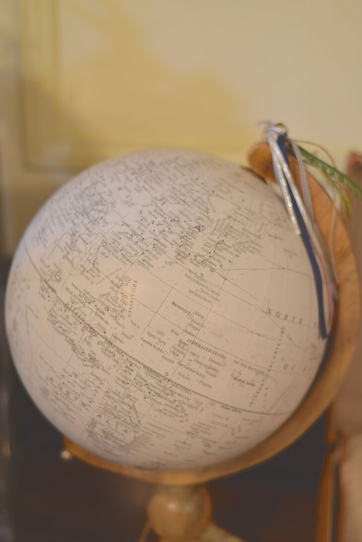 Instead of a traditional guest book, Erika and Ralph had their guests sign a vintage-style globe with their well wishes.