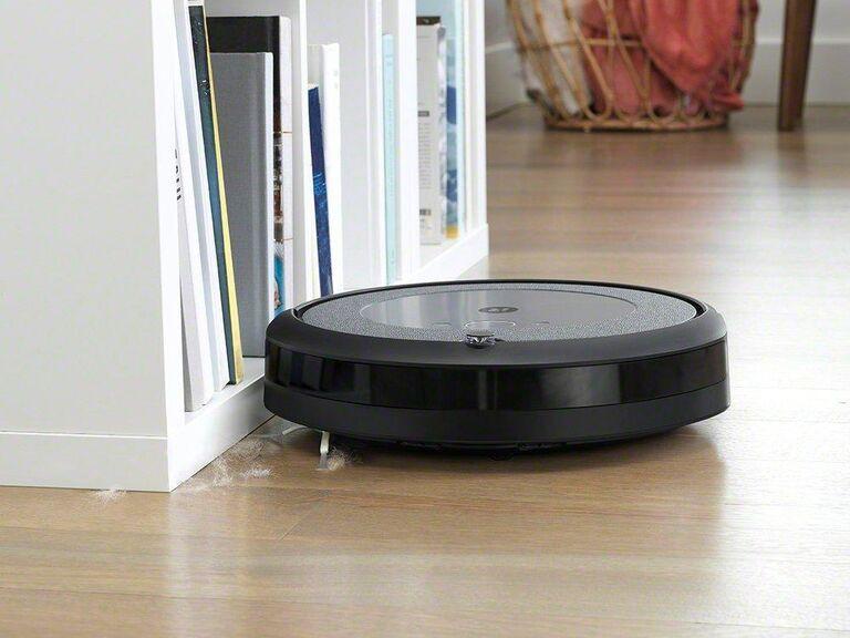 Black iRobot Roomba on wooden floor